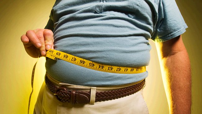 536876-man-measuring-his-waist